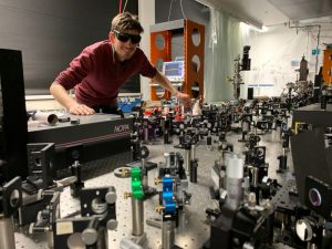Markus in the laser lab, fixing the equipment before an experiment.